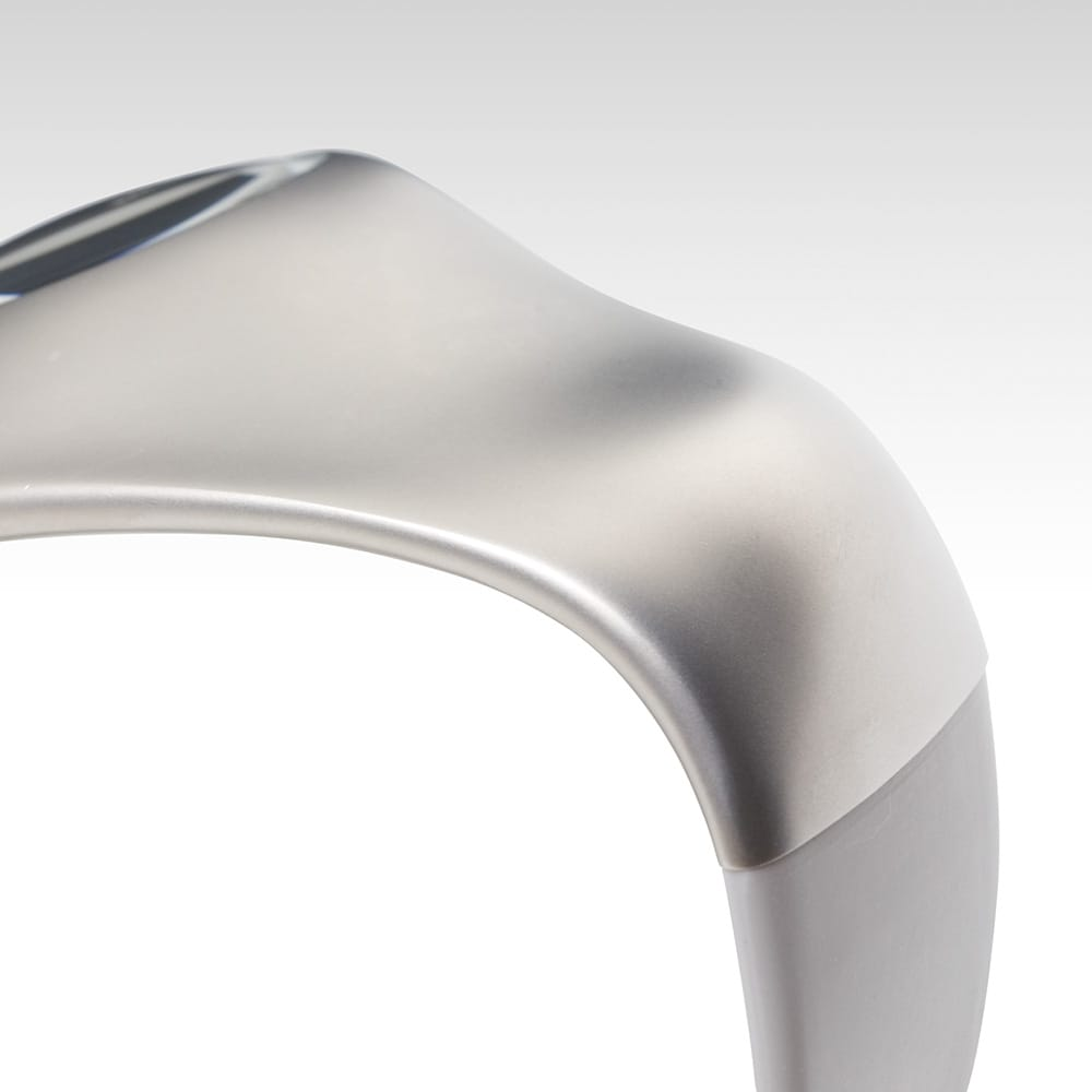 Gentle Shape.<span>The natural shape fits into curves of your wrists. Smooth titanium surfaces, which are felt like a living thing filled with vitality, realize a completely new watch. The joint area of a titanium case and a silicon band are smoothly processed to achieve a natural flow of the case.</span>