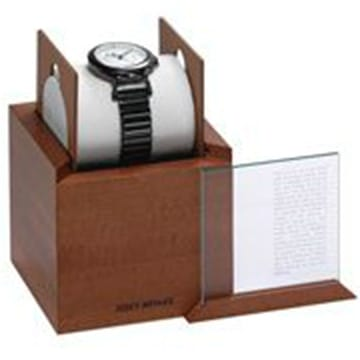 <span>The thick wood sides and sliding cover of this specially designed watch box suggest a display case in a museum of natural history. The box will remind you of how you felt when, as an inquisitive child, you carefully preserved the tiny creatures that you collected.</span>